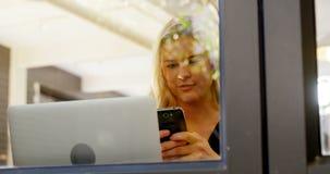 Beautiful woman using mobile phone 4k. Beautiful woman using mobile phone in office cafe 4k stock video footage