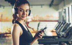 Beautiful woman using mobile smartphone during workout stock photography