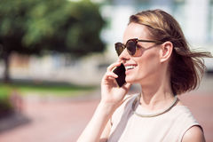 Beautiful woman using phone Stock Photo