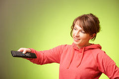 Beautiful woman using a remote controller Royalty Free Stock Image