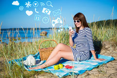 Beautiful woman using smart phone with different applications on Royalty Free Stock Photo