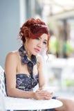 Beautiful woman using smartphone listen melancholic music Stock Photo