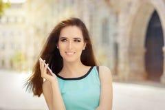 Beautiful Woman Using a Smartphone Royalty Free Stock Photo