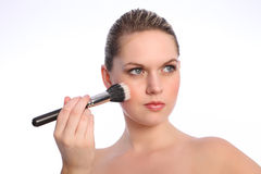 Beautiful woman using stippling make up brush Stock Image