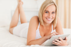 Beautiful woman using a tablet computer Stock Image