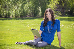 Beautiful woman using a tablet pc outdoors Royalty Free Stock Images