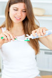 Beautiful woman using a toothbrush and toothpaste Stock Photography