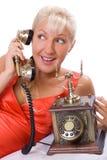 Beautiful woman using vintage phone. #3. Beautiful blond woman using vintage phone. #3 stock images