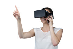 Beautiful woman using virtual reality headset and talking on mobile phone Stock Photos