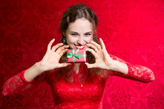 Beautiful woman with valentines day gift box present surprise Royalty Free Stock Photos