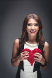 Beautiful woman with a Valentines heart Stock Image