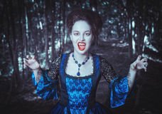 Beautiful woman vampire in medieval dress Royalty Free Stock Photo