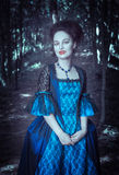 Beautiful woman vampire in medieval dress Stock Photos