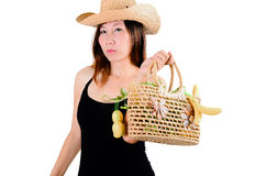 Beautiful woman with vegetables basket Stock Image