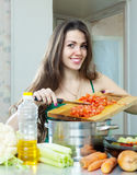 Beautiful woman with vegetables at  kitchen Royalty Free Stock Photo