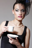 Beautiful woman in veil retro glamour beauty portrait with cup o. F tea or coffee royalty free stock photos