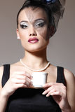 Beautiful woman in veil retro glamour beauty portrait. With cup of tea or coffee royalty free stock photography