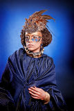 Beautiful woman in venetian mask with feathers and jewelry Stock Images