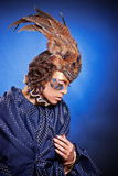 Beautiful woman in venetian mask with feathers and jewelry Royalty Free Stock Photos