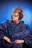 Beautiful woman in venetian mask with feathers and jewelry Stock Photos
