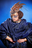 Beautiful woman in venetian mask with feathers and jewelry Royalty Free Stock Photo