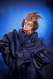 Beautiful woman in venetian mask with feathers and jewelry Stock Photo