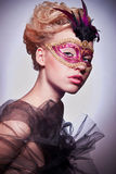 Beautiful woman in Venetian mask Stock Photography