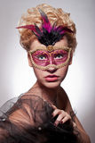 Beautiful woman in Venetian mask Stock Photo
