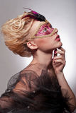 Beautiful woman in Venetian mask Stock Photography
