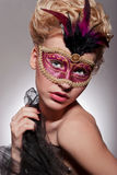 Beautiful woman in Venetian mask Stock Photos