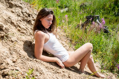 Beautiful woman in vest on sand Stock Photo