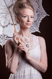Beautiful woman in victorian style holding a lace umbrella Stock Photo