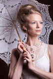 Beautiful woman in victorian style holding a lace umbrella Stock Images