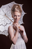 Beautiful woman in victorian style holding a lace umbrella Royalty Free Stock Photo