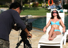 Beautiful woman and video-operator Royalty Free Stock Images