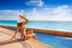Beautiful woman view from back sunbathing on pier Royalty Free Stock Images