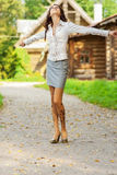 Beautiful woman in village lane Stock Photography