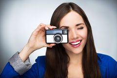 Beautiful woman with vintage camera Stock Photos