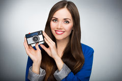 Beautiful woman with vintage camera Stock Images