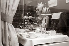 Beautiful woman in vintage clothing enjoying afternoon tea in train carriage royalty free stock photography