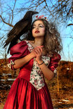 Beautiful woman in vintage red dress with a black Stock Images