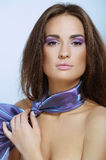 Beautiful woman with violet color scarf Royalty Free Stock Image