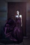 Beautiful woman in violet dress Royalty Free Stock Images