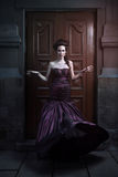 Beautiful woman in violet dress Royalty Free Stock Photos