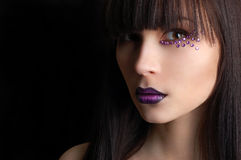 Beautiful woman with violet make-up Stock Photos