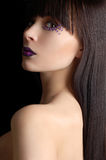 Beautiful woman with violet make-up royalty free stock photo