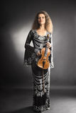 Beautiful woman with violin Stock Photography