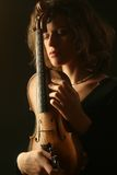 Beautiful woman violinist with violin on black. Portrait of violinist with his acoustic violin Royalty Free Stock Photography
