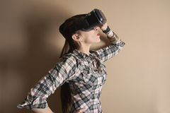 Beautiful woman with virtual reality glasses, standing in profil Stock Photo