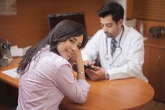 Beautiful woman visiting the doctor Stock Photography